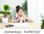 child holding house in hands | Shutterstock . vector #512967310