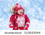 baby playing with snow in... | Shutterstock . vector #513033544