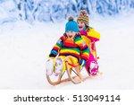 little girl and boy enjoying... | Shutterstock . vector #513049114