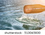 oar of boat touching water and... | Shutterstock . vector #513065830