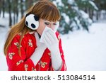 Small photo of Pretty young woman blowing her nose with a tissue outdoor in winter. Young woman blowing her nose on a handkerchief conceptual of an illness, flu, cold, allergic rhinitis
