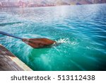 Oar Of Boat Touching Water And...