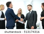 handshake to seal a deal after... | Shutterstock . vector #513174316