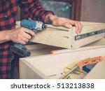 a carpenter is building a... | Shutterstock . vector #513213838
