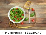 fresh salad and measuring tape... | Shutterstock . vector #513229240