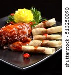 peking duck eating with spring... | Shutterstock . vector #513250090