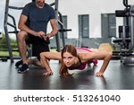 athletic girl performs push ups | Shutterstock . vector #513261040