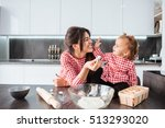 funny girl with mom on kitchen. ... | Shutterstock . vector #513293020