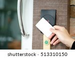 Small photo of electronic key access system with woman hand to lock and unlock doors