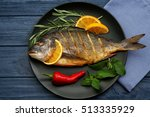 tasty fish with vegetables and... | Shutterstock . vector #513335929