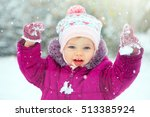 little baby girl playing in snow | Shutterstock . vector #513385924