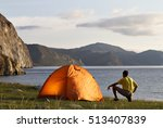tourist near a tent in the... | Shutterstock . vector #513407839