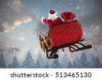 Santa Claus Riding On Sled Wit...