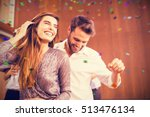 cheerful young dancing couple... | Shutterstock . vector #513476134