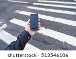 holding phone in hand in the... | Shutterstock . vector #513546106