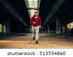 man in red hoodie running under ... | Shutterstock . vector #513554860