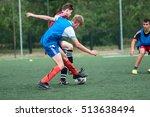 Small photo of Orenburg, Russia - 9 July 2016: The boys play football at the city tournament on mini-football among childrens amateur teams memory trainer Kolosova