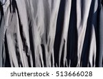 Small photo of Black fabric cloth texture,Lights and shadows alternating on waves of fabric