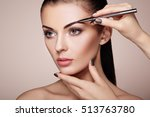 beautiful brunette woman paints ... | Shutterstock . vector #513763780