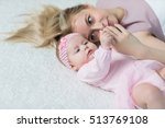 mother playing with her baby | Shutterstock . vector #513769108