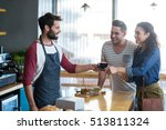 waiter serving a coffee to... | Shutterstock . vector #513811324