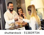 Small photo of Picture of couple and receptionist at counter in hotel