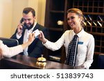 Stock photo picture of guests getting key card in hotel 513839743