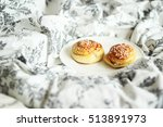 two cinnamon buns on a plate in ...   Shutterstock . vector #513891973