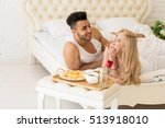 Young Couple Lying In Bed Eat...