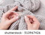 Close Up Of Hands Knitting....