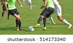 men are playing soccer outdoors | Shutterstock . vector #514173340