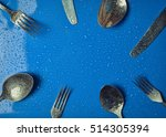 Cutlery In Water Droplets.