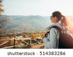 woman enjoying view on top of... | Shutterstock . vector #514383286