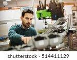 Creative mechanical engineer working on machines
