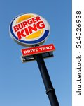 Small photo of Eskilstuna, Sweden - June 14, 2014: Burger King Drive in road sign against blue sky at the restaurant located at the Vasterleden. Photographed vertically and slightly diagonal.