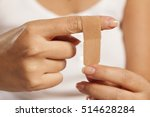 woman puts a plaster on her... | Shutterstock . vector #514628284