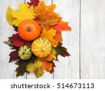 Pumpkin and autumn  leaves on a ...