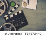 clapperboard and a film reel  a ... | Shutterstock . vector #514673440