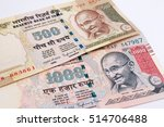 Small photo of India banknote. India rupee 500, 1000 banknote declared illegal. 500, 1000 Rupee note banned. Cancelled banknote concept. Mahatma Gandhi of India on Indian 500, 1000 rupee banknote cancelled.