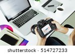 Bangkok, Thailand - July 30, 2016: Photographer checking camera Canon 6d model device on desk, Canon camera is manufactured by Canon Inc., - stock photo