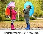 Cute Children With Umbrellas I...