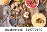 table with raclette cheese ... | Shutterstock . vector #514770640
