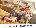 man cutting grass in his yard... | Shutterstock . vector #514796578
