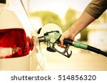 hand refilling the car with... | Shutterstock . vector #514856320