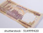 Small photo of Back side of India banknote 500 rupee. India rupee 500 banknote declared illegal. 500 rupee note banned. Mahatma Gandhi of India on Indian 500 rupee banknote. Cancelled banknote concept.