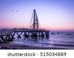 los muertos pier at sunset  ... | Shutterstock . vector #515034889