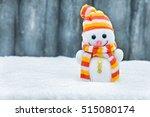 Happy Snowman Toy On The Bokeh...