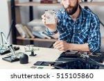 bearded repairman shows broken... | Shutterstock . vector #515105860