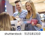 young woman paying by cash in... | Shutterstock . vector #515181310