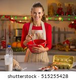 happy young housewife whisking... | Shutterstock . vector #515255428